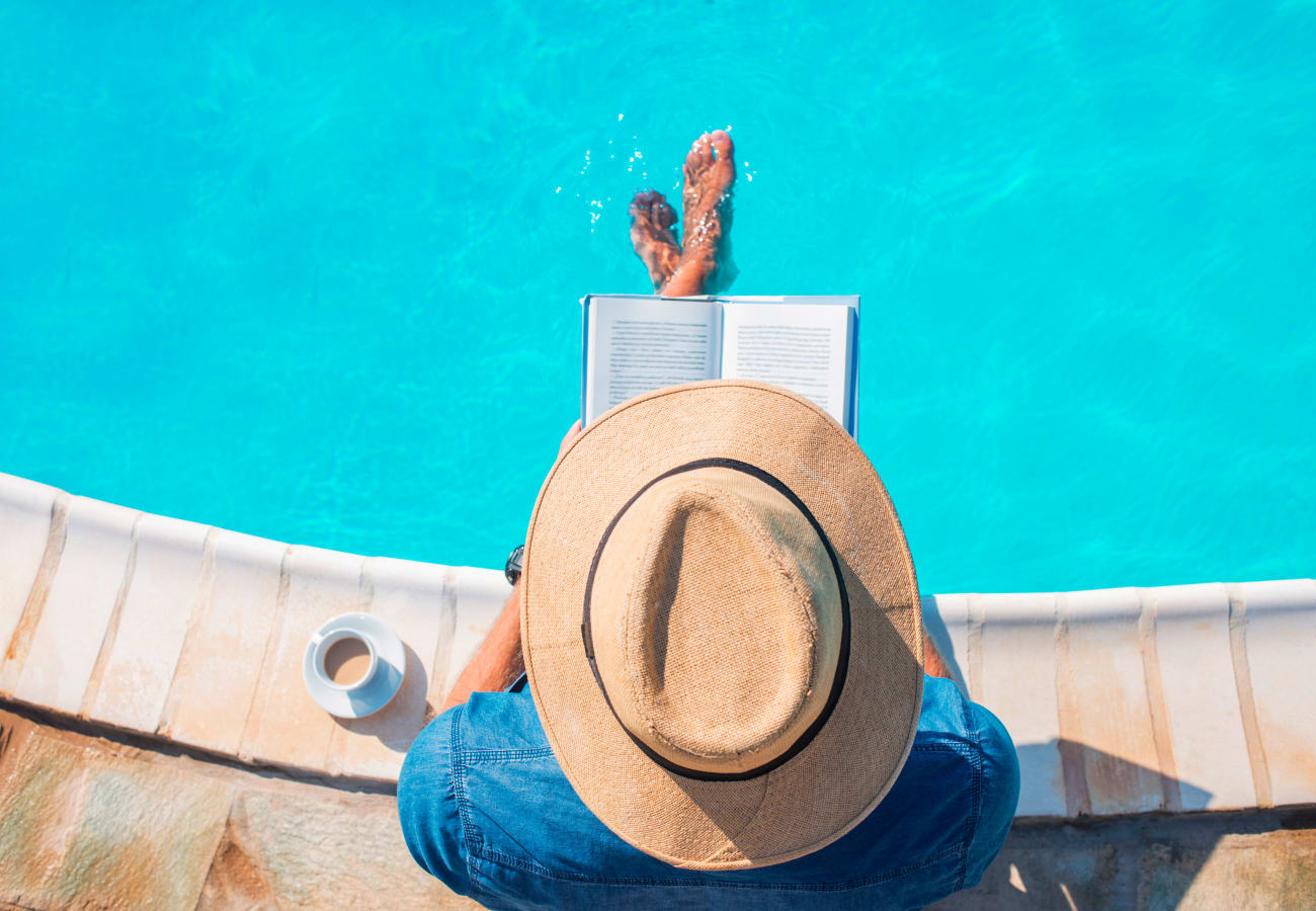 Resident reading by the swimming pool at Brentwood in Chula Vista, California