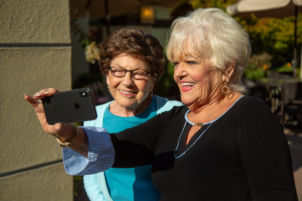 Happy residents taking a selfie at  senior living in Huntington Beach