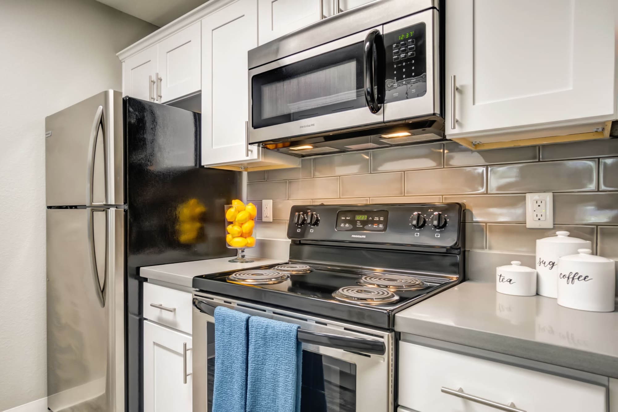 A kitchen, with tile backsplash at Serramonte Ridge Apartment Homes in Daly City, California