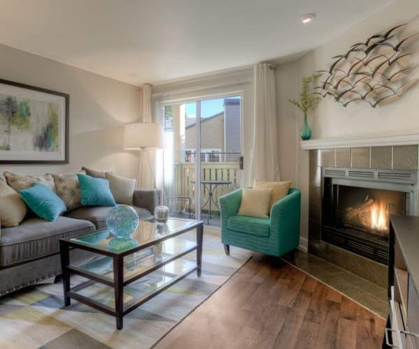 spacious living room and fireplace at Newport Crossing Apartments in Newcastle