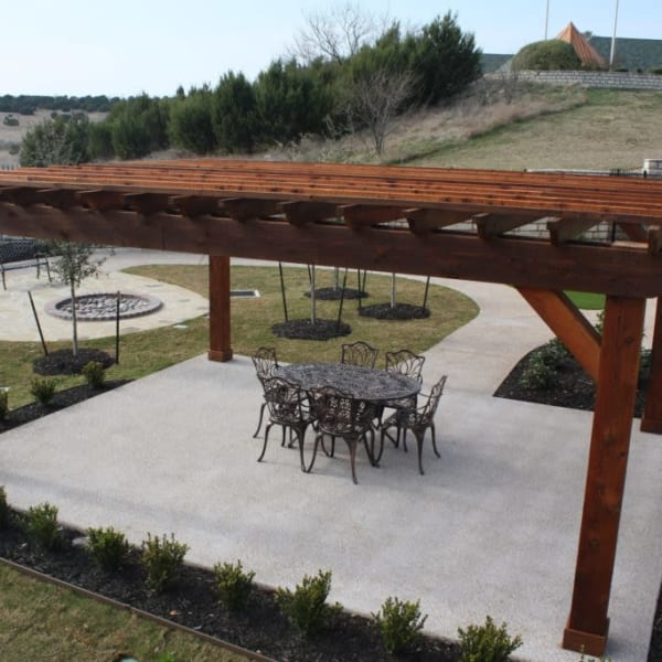 Covered area of the community patio at Quail Park of Granbury in Granbury, Texas