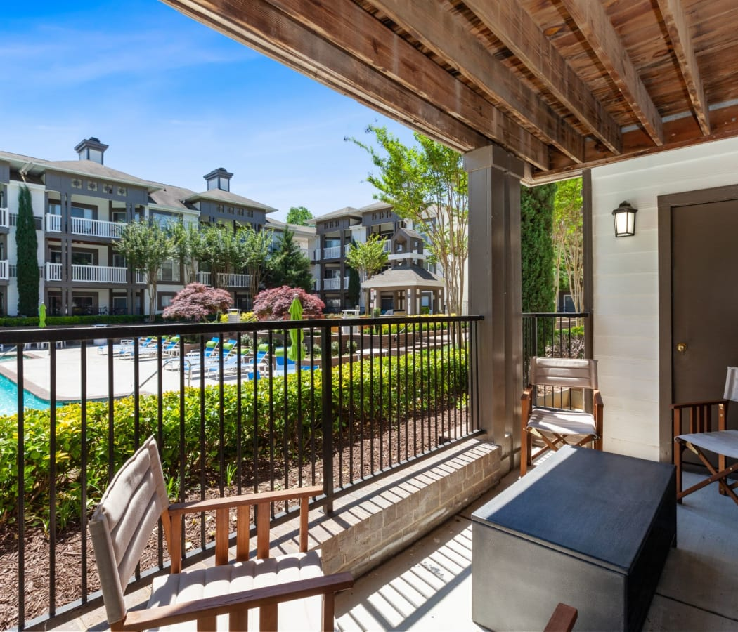 View of the sparkling swimming pool from the private patio at 45Eighty Dunwoody Apartment Homes in Dunwoody, Georgia
