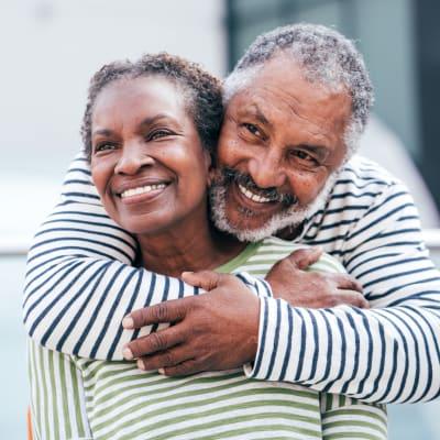 Resident couple embracing at Arbor Glen Senior Living in Lake Elmo, Minnesota