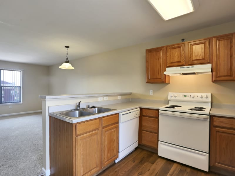 Modern kitchen at Belle Creek Apartments in Henderson, CO