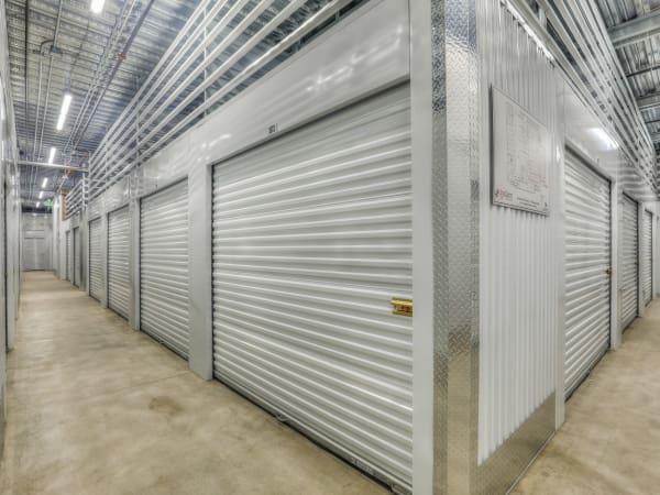 Hallway of units at StorQuest Self Storage in Aurora