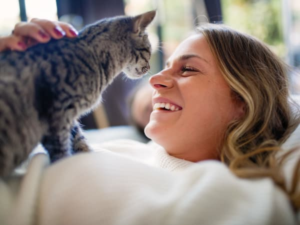 Resident and her happy cat in their pet-friendly home at EVIVA Midtown in Sacramento, California