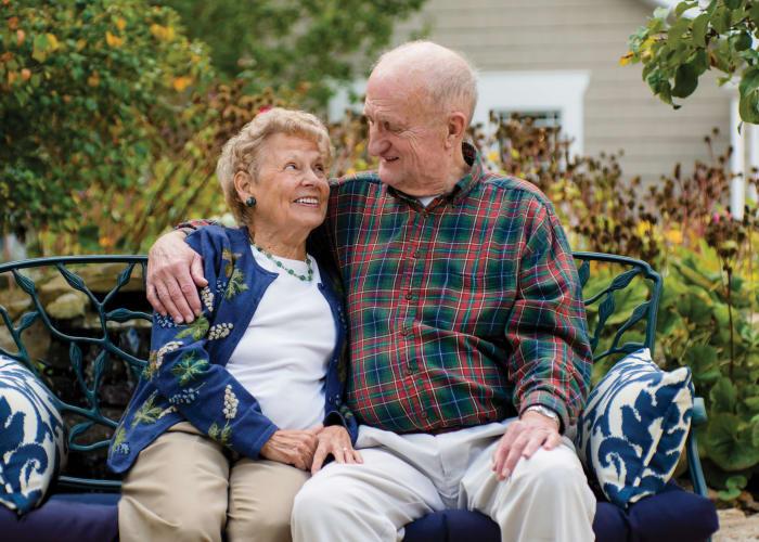 Couple sitting outside at Maplewood at Orange in Orange, Connecticut
