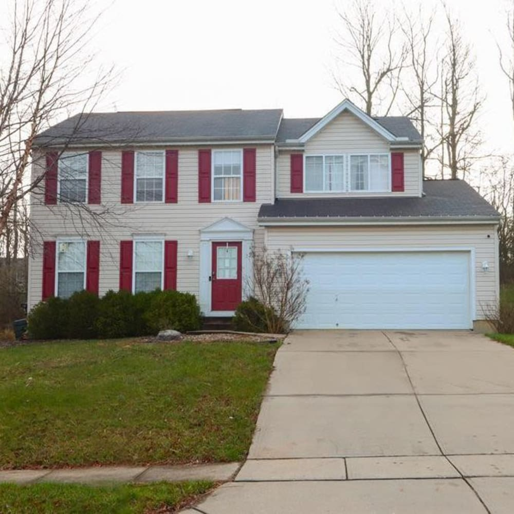 Large home with nice lawn in front of house at Legacy Management in Ft. Wright, Kentucky