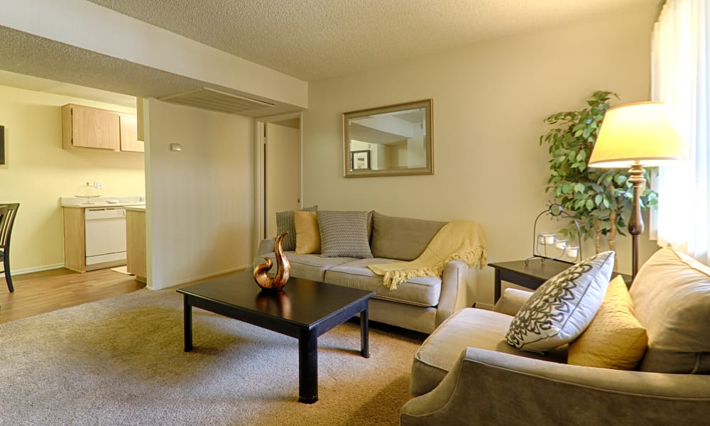 Comfortable living room & great for entertaining at Creekside Village Apartment Homes in San Bernardino, CA