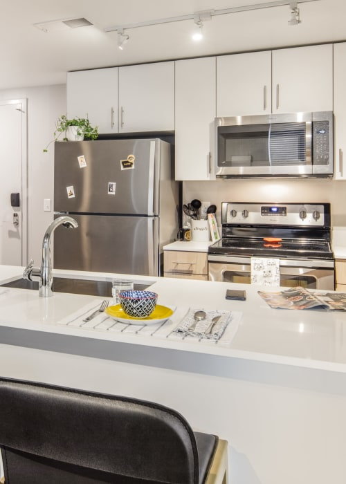 Kitchen with stainless steel appliances at RISE at Riverfront Crossings in Iowa City, Iowa