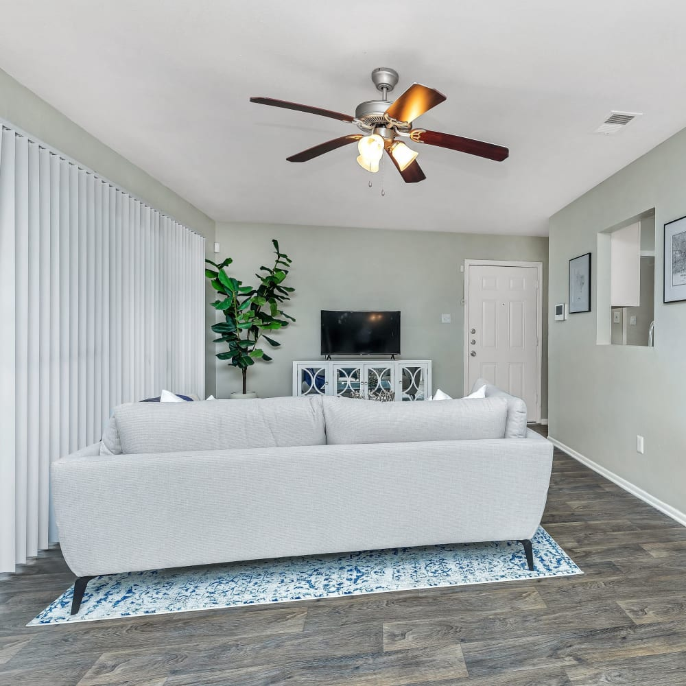 A large living room with patio access at Barringer Square in Webster, Texas