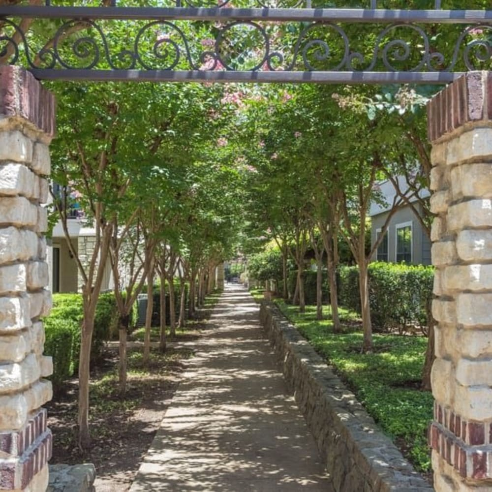 Beautiful shaded walkway at The Verandas at Timberglen in Dallas, Texas