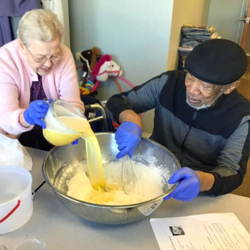 Resident couple baking at Canoe Brook Assisted Living & Memory Care in Catoosa, Oklahoma