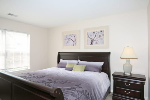 A spacious bedroom at Bennington Hills Apartments in West Henrietta, New York