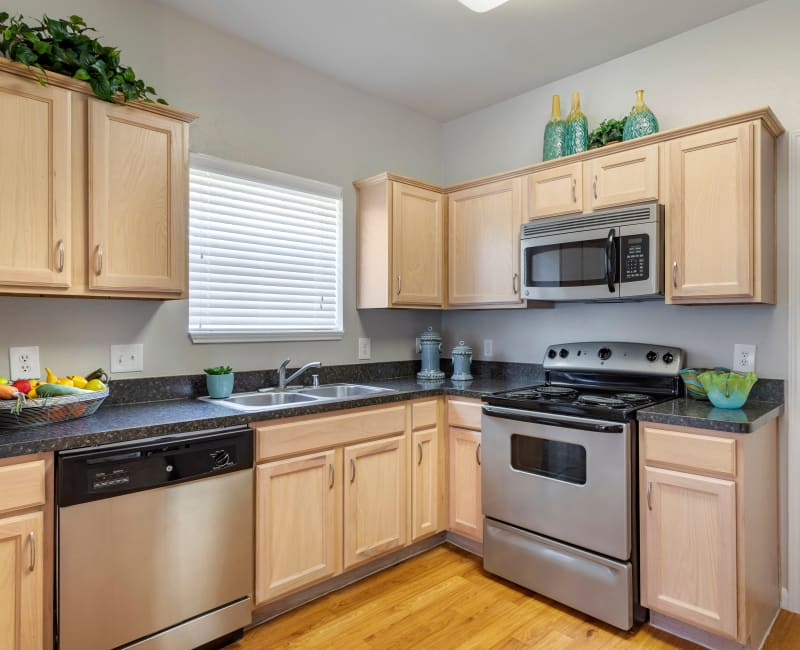 Model kitchen with stainless steel appliances and space saver built-in microwave at Regency at First Colony in Sugar Land, Texas