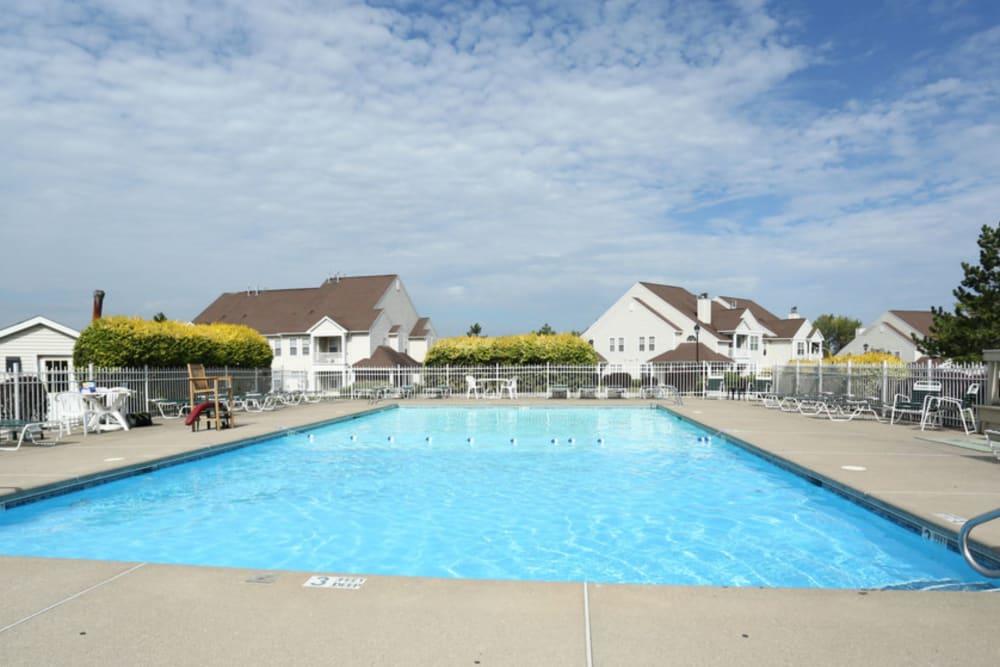 Poolside view at Bennington Hills Apartments in West Henrietta, New York