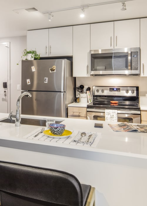 Fully equipped kitchen at RISE at Riverfront Crossings in Iowa City, Iowa