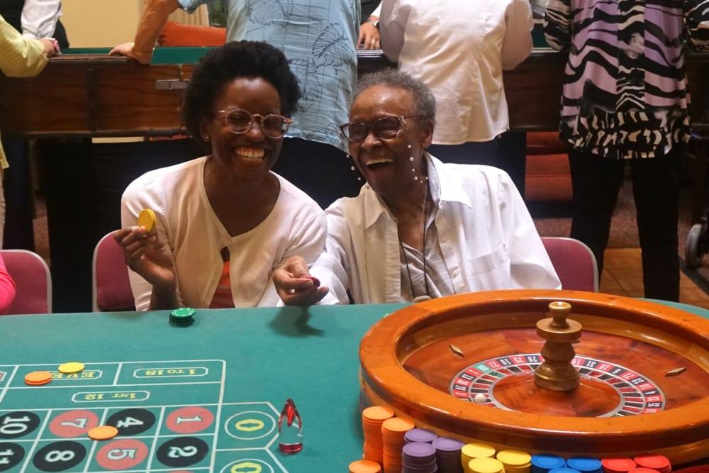 Resudents enjoying fun games on casino night at Winding Commons Senior Living in Carmichael, California
