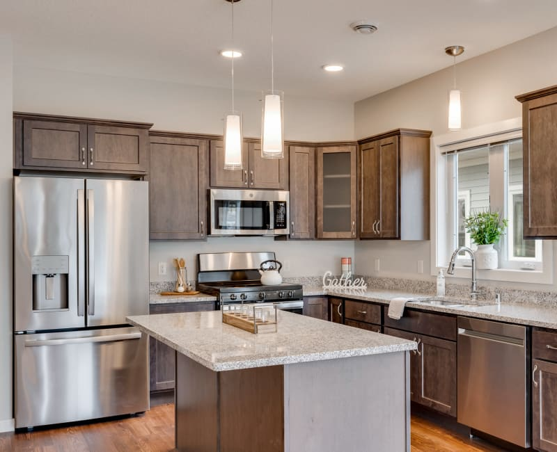 Kitchen with island at The Fields at Arbor Glen in Lake Elmo, Minnesota