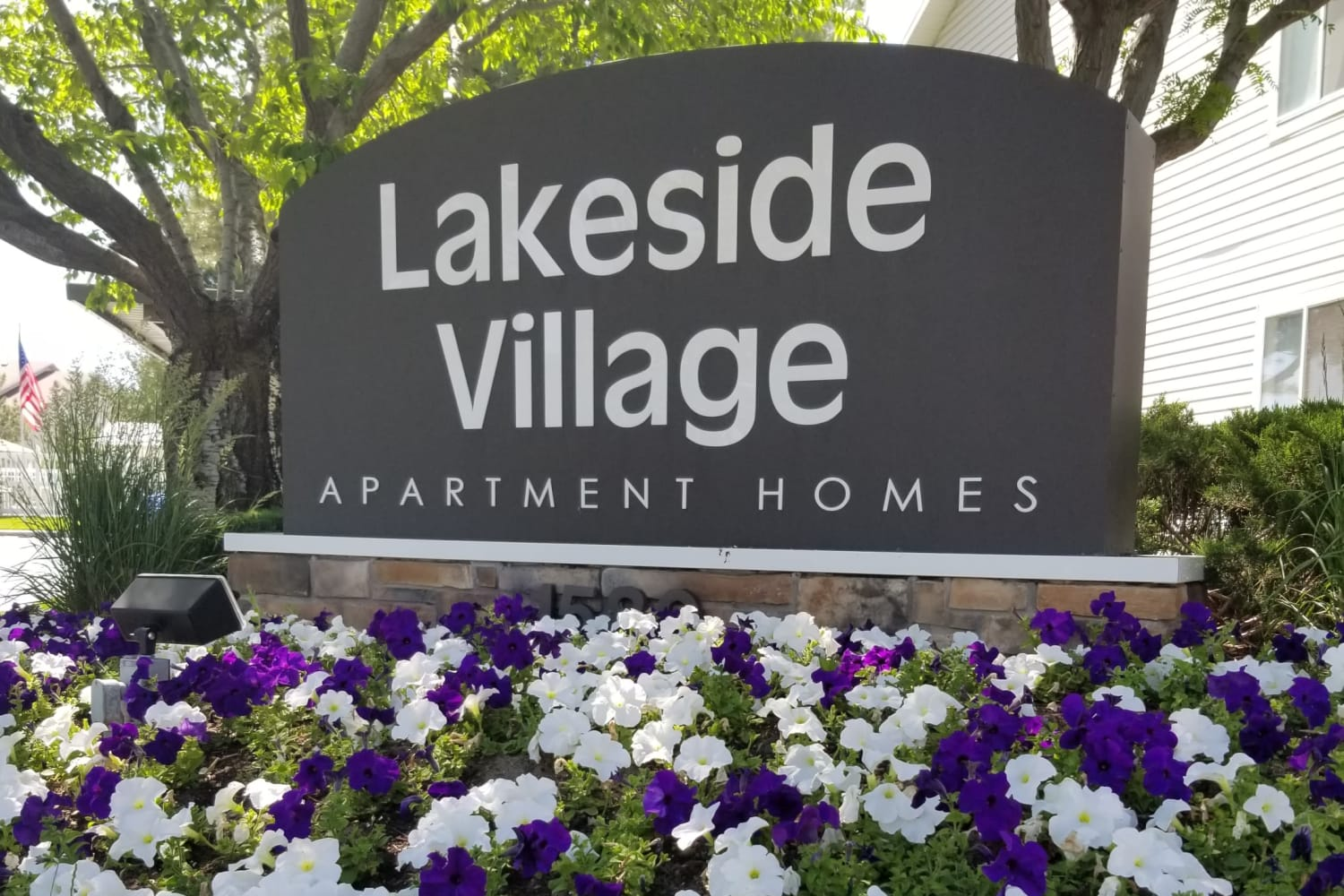 Front entrance sign at Lakeside Village Apartments in Salt Lake City, Utah