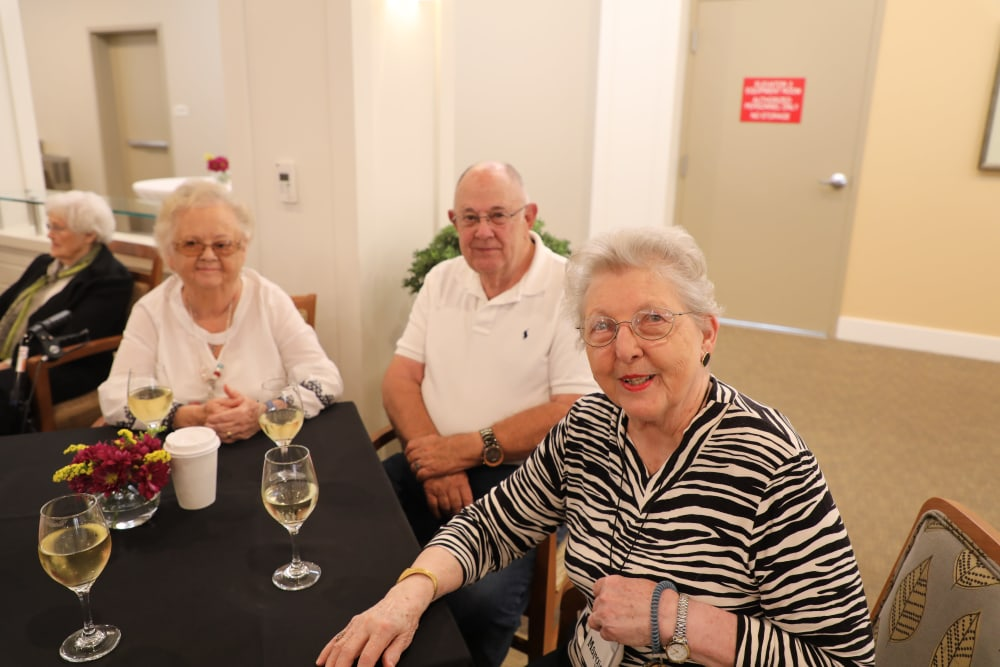 Residents having dinner together at Merrill Gardens at Madison in Madison, Alabama.