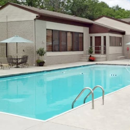 Sparkling pool with sundeck patio and lounge seating at Lakeside Landing Apartments in Lakeside Park, Kentucky