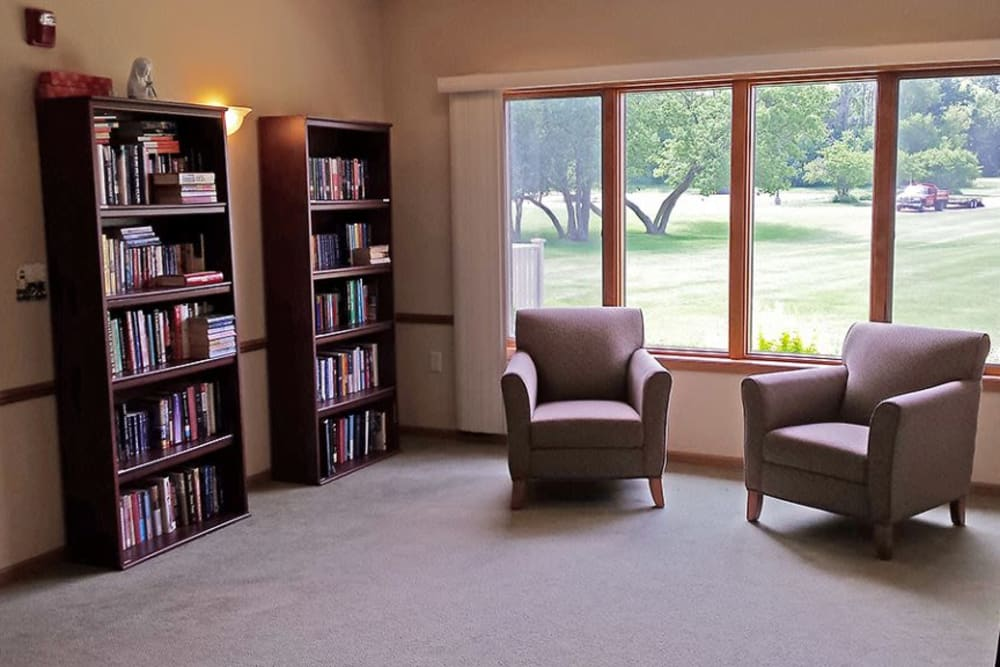 Brightly lit resident library and sitting area at Arbor View in Burlington, Wisconsin.
