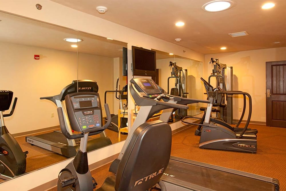 Resident exercise room with equipment at Milestone Senior Living in Eagle River, Wisconsin.