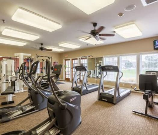 Fully equipped fitness center at Oakmonte Apartments in Webster, New York