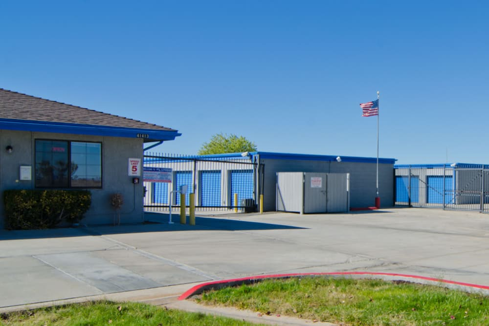 Fenced outdoor storage units at A-American Self Storage in Palmdale, California