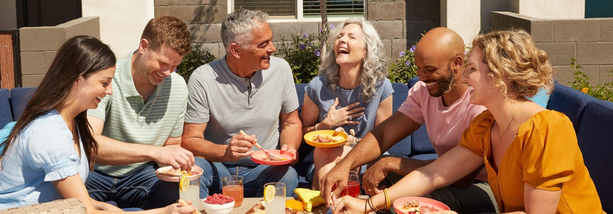 Friends enjoying food at Las Casas at Windrose in Litchfield Park, Arizona