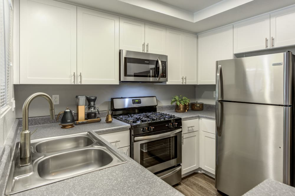 Renovated white kitchen cabinetry at Village Oaks in Chino Hills, California