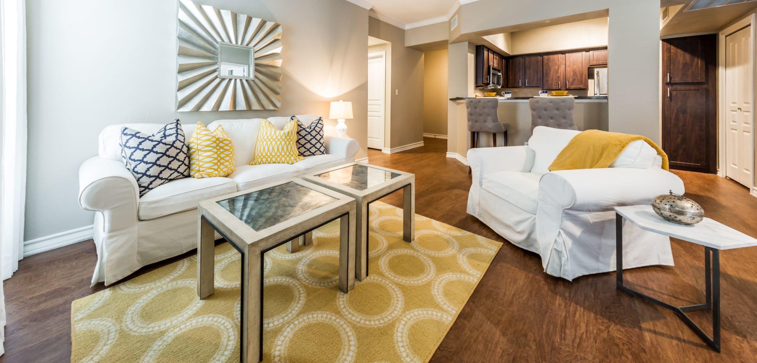 Living room with wood style floors at Marquis at Deerfield in San Antonio, Texas