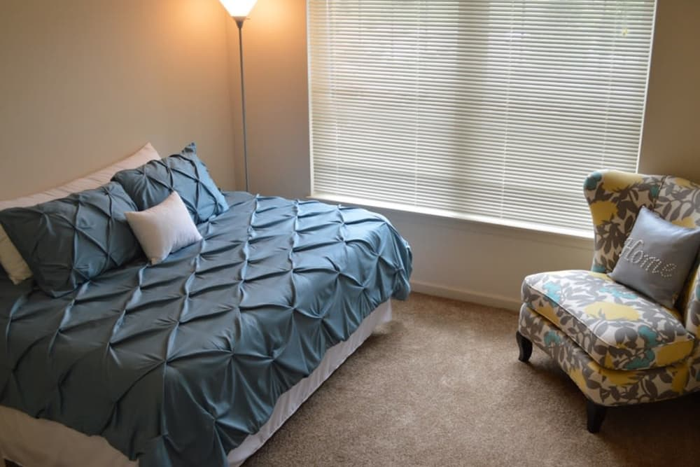 Luxury bedroom at Greenwood Cove Apartments home in Rochester, NY