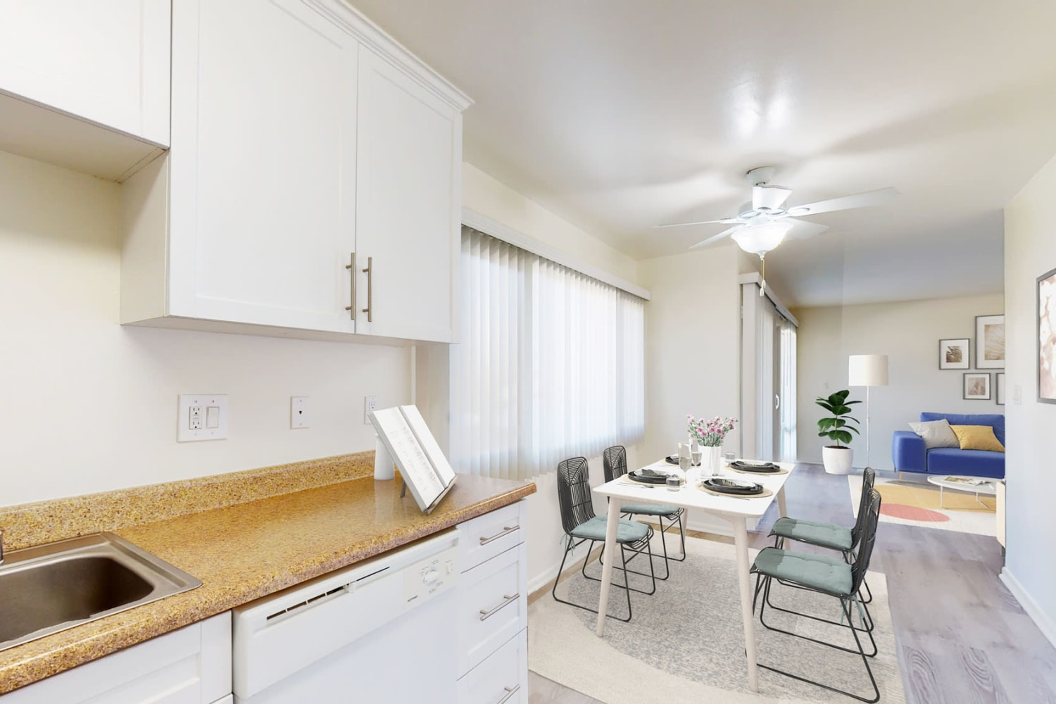 One bedroom home's kitchen with bright white cabinetry at West Park Village in Los Angeles, California