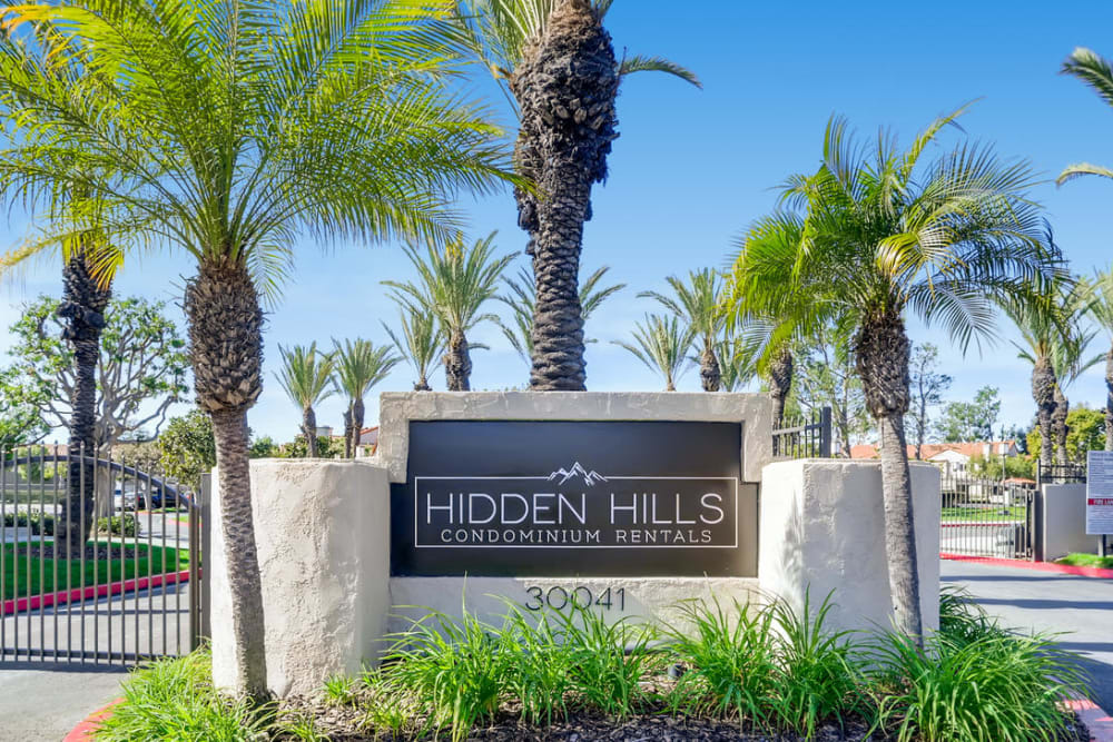 Beautifully landscaped sign at Hidden Hills Condominium Rentals in Laguna Niguel, California
