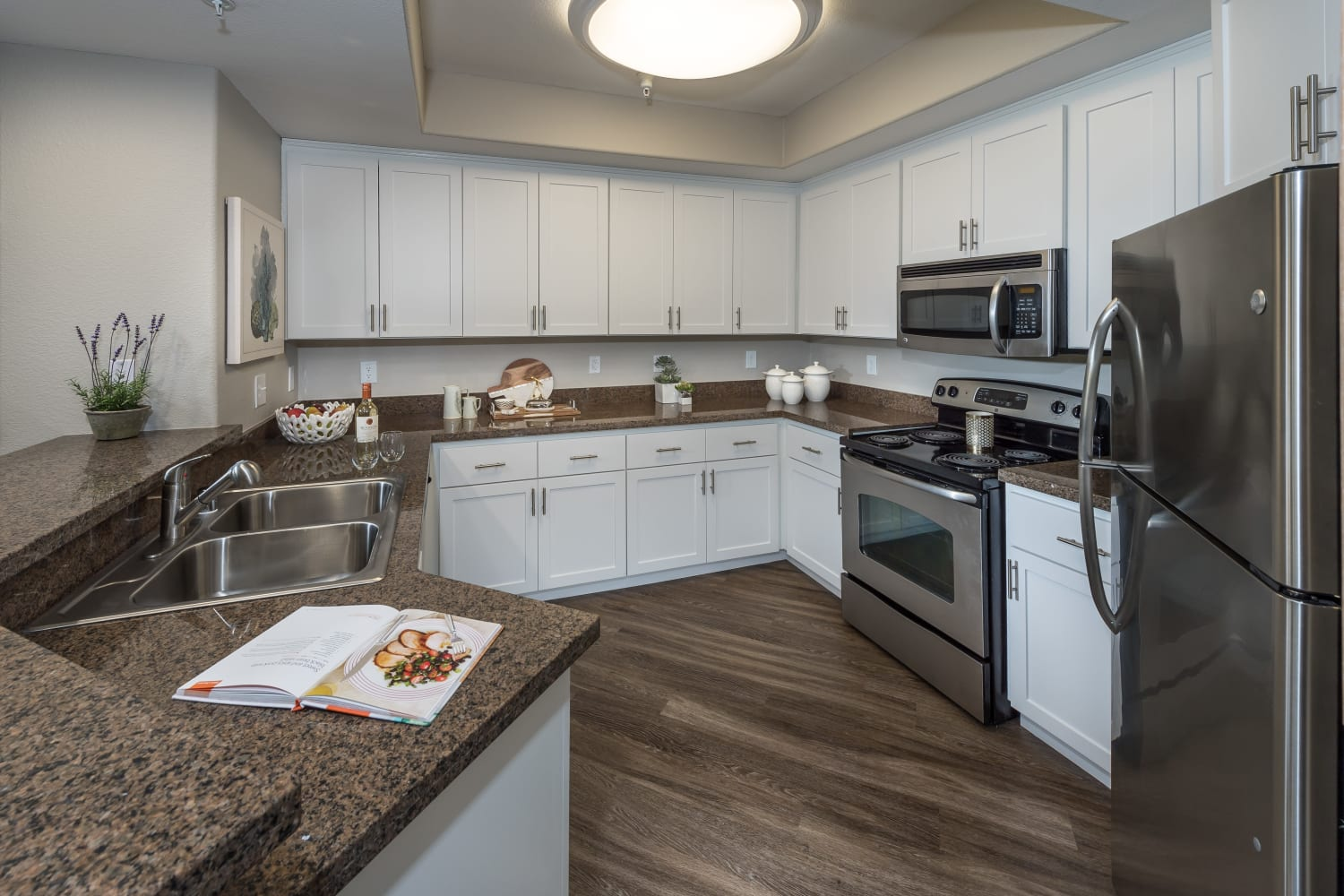 Large kitchen with ample storage space at The Carlyle in Santa Clara, California