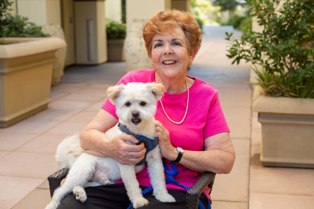Resident with pet at our senior living community in Rolling Hills Estates