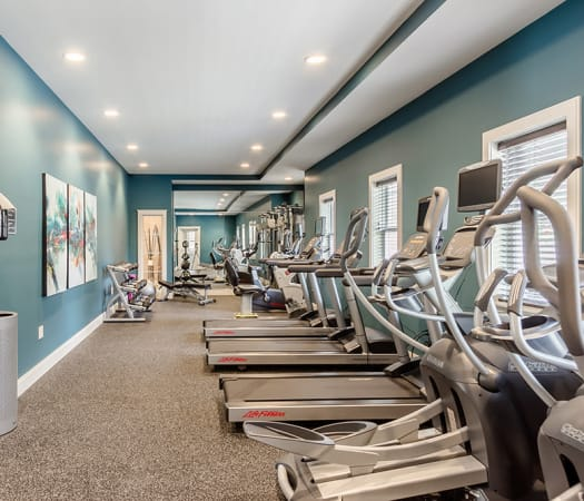 Fully equipped fitness center at Ellison Heights Apartments in Rochester, New York