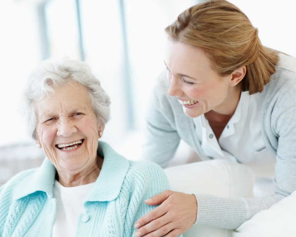 Staff member visits resident at Sunset Park Place in Dubuque, Iowa.