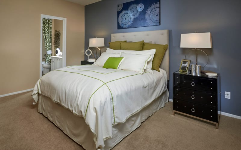Spacious master bedroom with plush carpeting at Legend Oaks Apartments in Aurora, Colorado