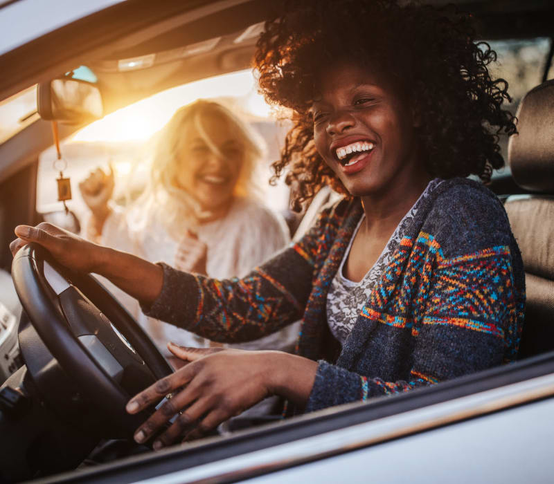 Resident laughing with friend while driving near The Terrace in Tarzana, California