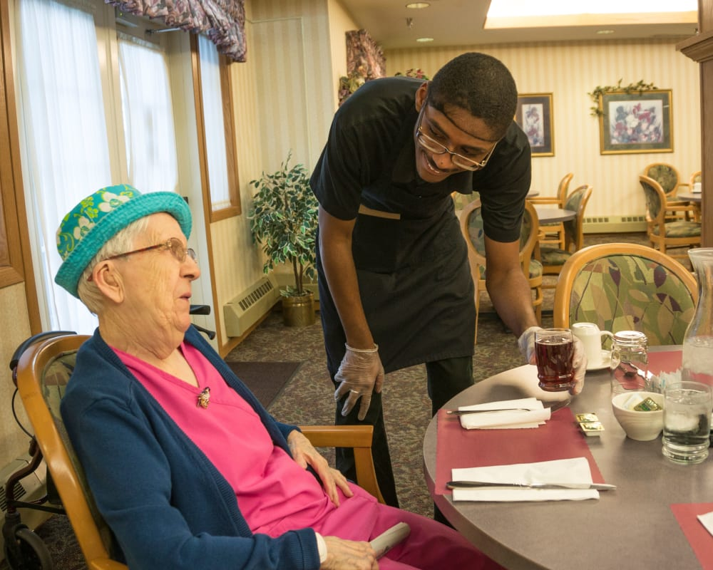 Staff takes resident's order in dining room at Meadow Lakes Senior Living in Rochester, Minnesota.