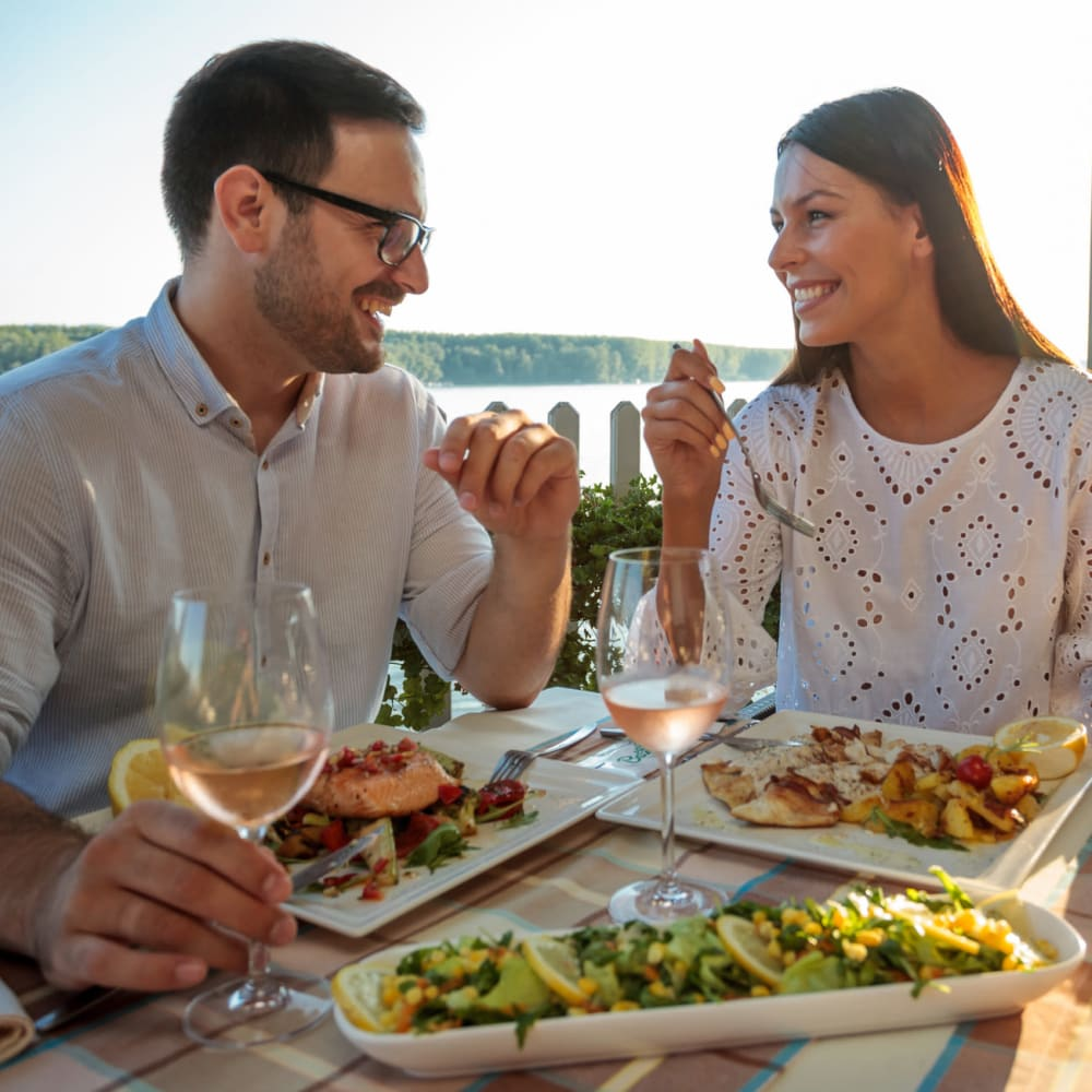 Couple enjoying harborside dining at one of the restaurants at Portside Ventura Harbor in Ventura, California