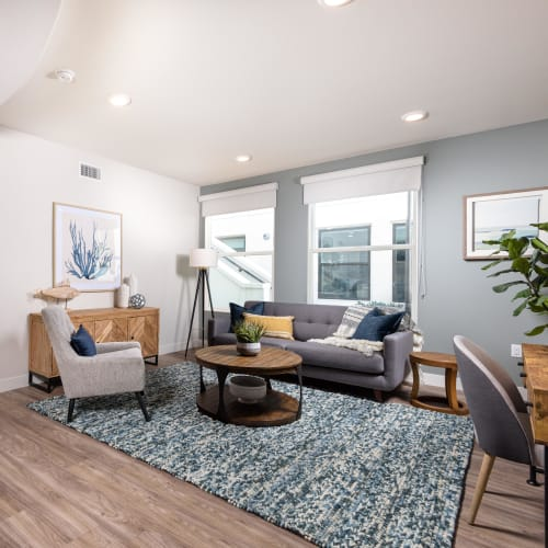 Well-furnished living space in a model home at Portside Ventura Harbor in Ventura, California