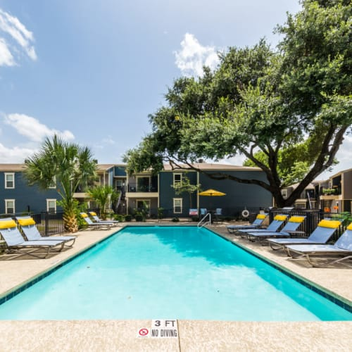 Smaller lounge pool area with lounge chairs at Austin Midtown in Austin, Texas