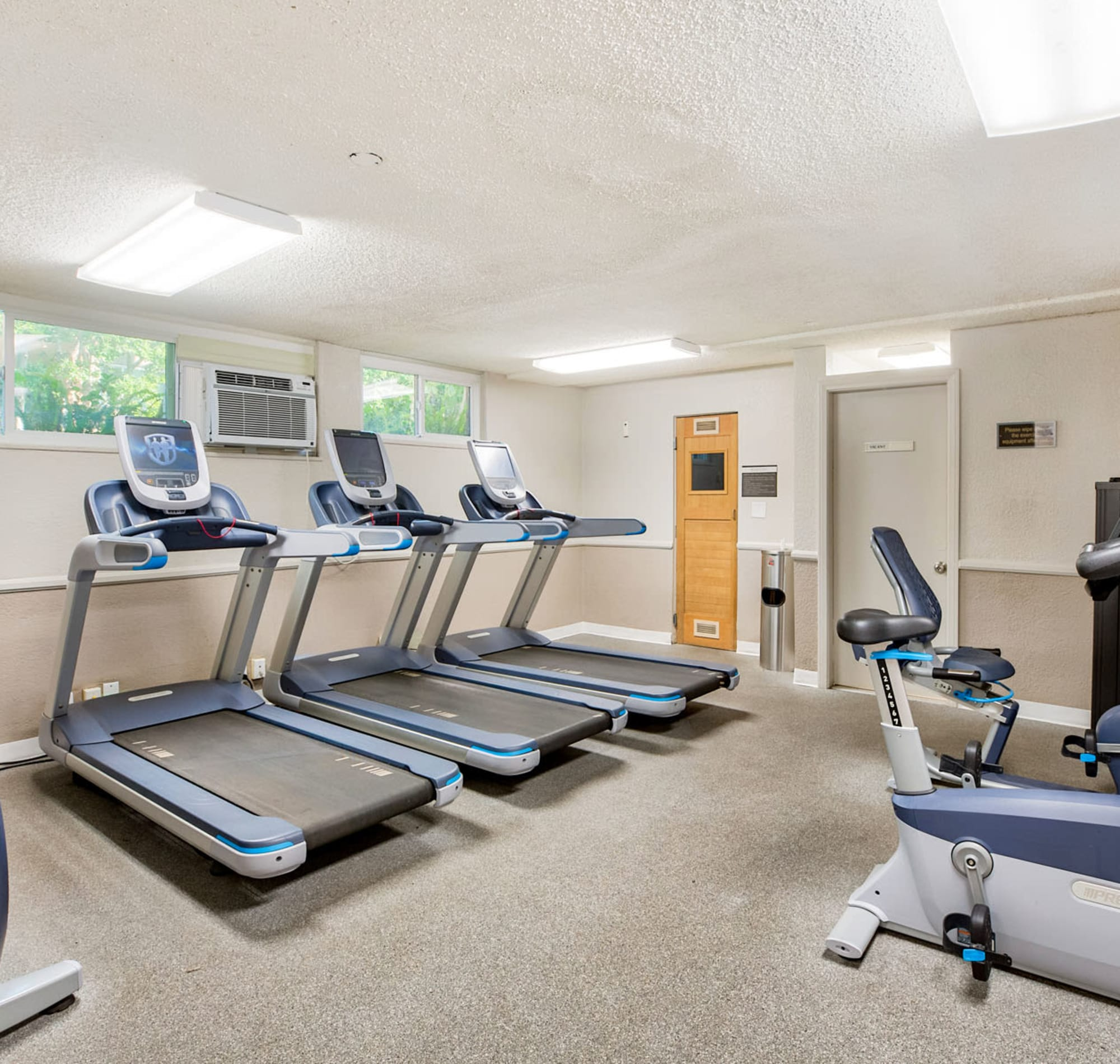 Well-equipped onsite fitness center with plenty of cardio equipment at Casa Granada in Los Angeles, California