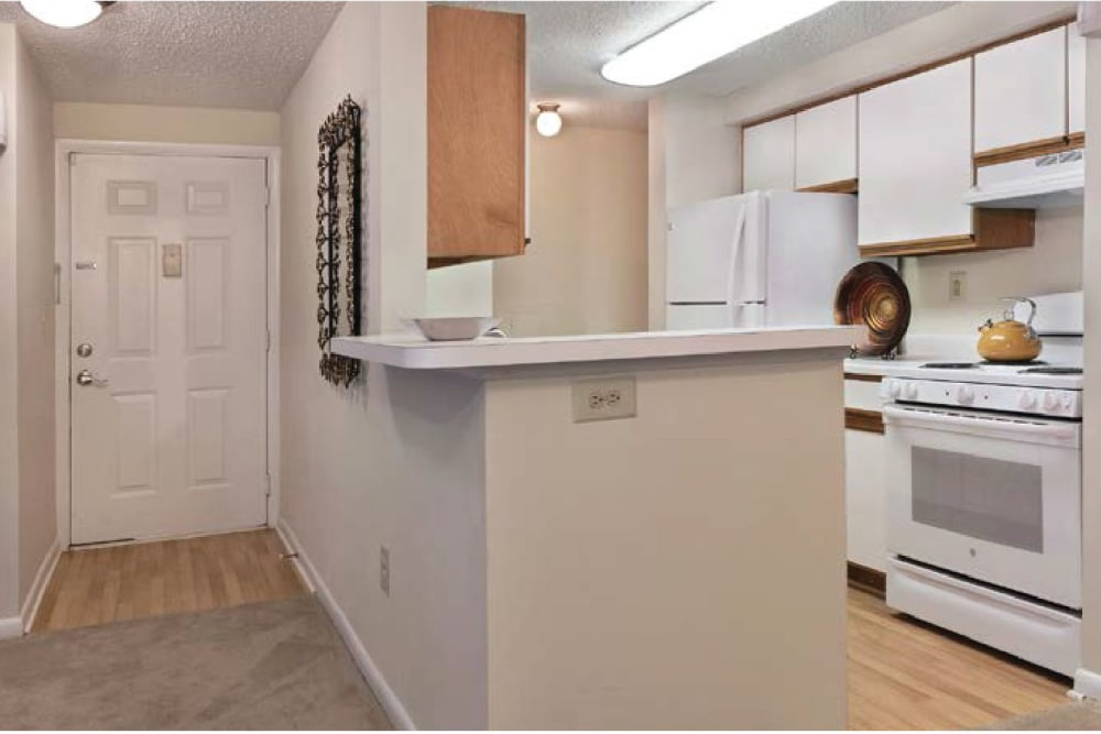 The entrance way and kitchen layout at Kingscrest Apartments in Frederick, Maryland