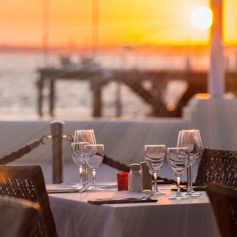 Table set at sunset at one of the harborside restaurants at Portside Ventura Harbor in Ventura, California