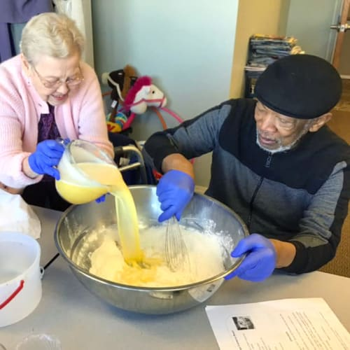 Two Residents cooking food together at Canoe Brook Assisted Living & Memory Care in Catoosa, Oklahoma